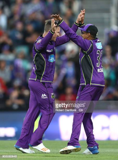 Darcy Short of the Hurricanes celebrates with Clive Rose after taking the wicket of Joe Burns of the Heat during the Big Bash League match between...