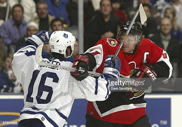 Darcy Tucker of the Toronto Maple Leafs battles with Daniel Alfreedsson of the Ottawa Senators during their NHL game at the Air Canada Centre April...