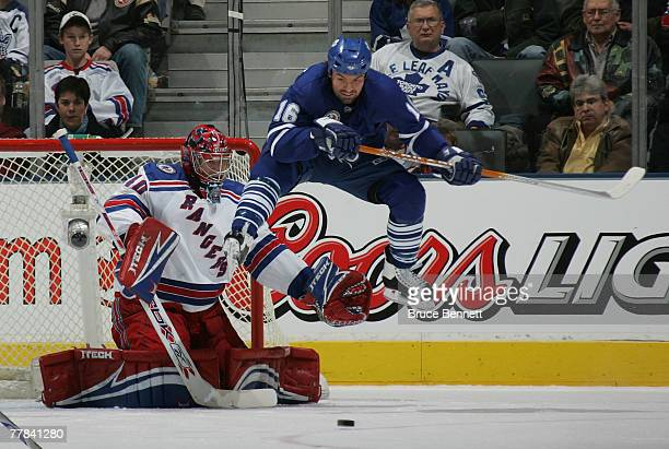 Darcy Tucker of the Toronto Maple Leafs jumps to screen goaltender Steve Valiquette of the New York Rangers during second period action on November...