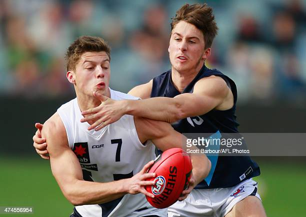Darcy Tucker of Vic Country and Tom Phillips of Vic Metro compete for the ball during the U18 Championship match between Vic Metro and Vic Country at...