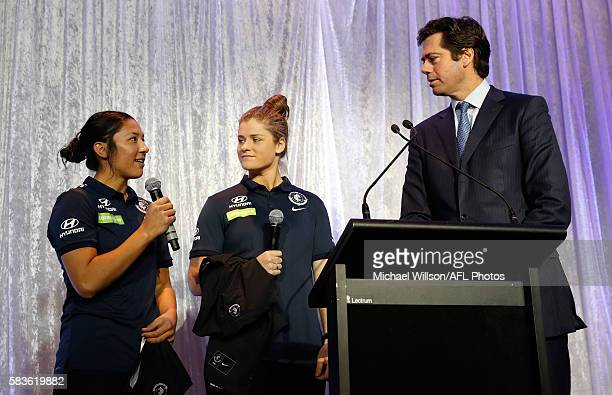Darcy Vescio of the Blues and Briana Davey of the Blues chat with Gillon McLachlan Chief Executive Officer of the AFL during the Women's League...