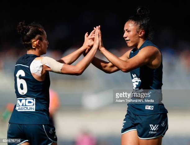 Darcy Vescio of the Blues celebrates a goal with Gabriella Pound of the Blues during the 2017 AFLW Round 02 match between the Carlton Blues and the...