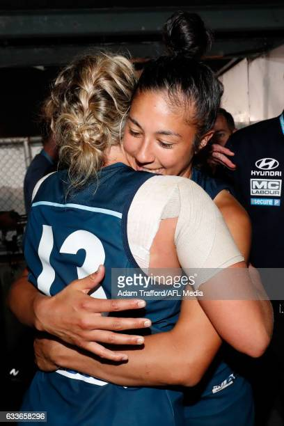 Darcy Vescio of the Blues hugs Lauren Arnell of the Blues during the 2017 AFLW Round 01 match between the Carlton Blues and the Collingwood Magpies...