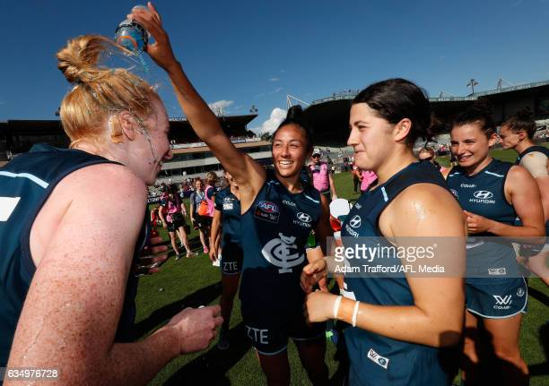 Darcy Vescio of the Blues pours Gatorade on Kate Shierlaw of the Blues during the 2017 AFLW Round 02 match between the Carlton Blues and the GWS...