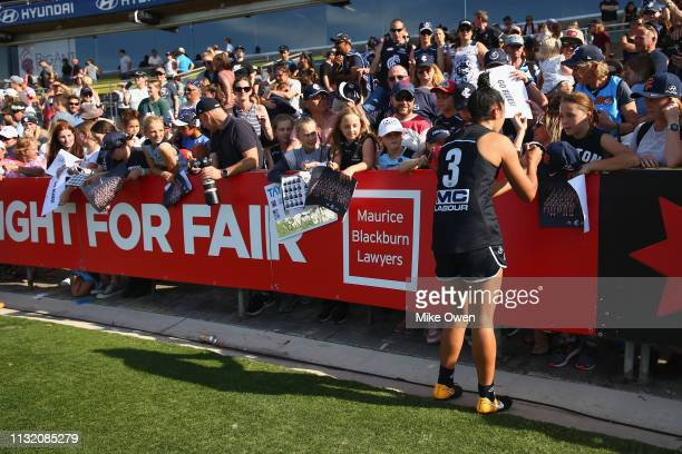 Darcy Vescio of the Blues signs autographs for fans after the AFLW Preliminary Final match between the Carlton Blues and the Fremantle Dockers at...