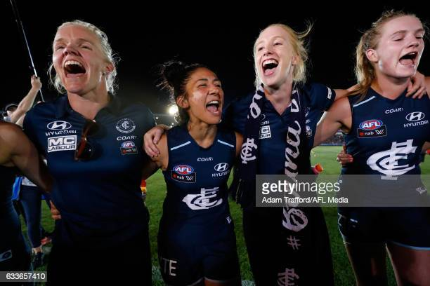 Darcy Vescio of the Blues sings the team song during the 2017 AFLW Round 01 match between the Carlton Blues and the Collingwood Magpies at Ikon Park...