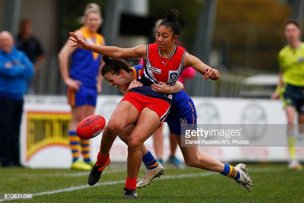 Darcy Vescio of the Falcons is tackled by Jasmine Grierson of the Eagles during the VFL Women's match between Cranbourne and Darebin at Casey Fields...