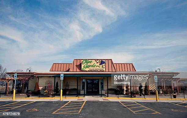 Darden Restaurants Inc. Olive Garden location stands in Peoria, Illinois, U.S., on Tuesday, March 18, 2014. Darden Restaurants Inc. Is scheduled to...
