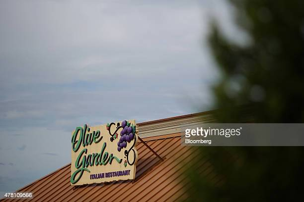 Darden Restaurants Inc Olive Garden signage is displayed outside of a location in Louisville Kentucky US on Monday June 22 2015 Darden Restaurants...