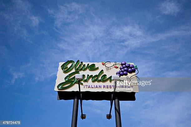Darden Restaurants Inc Olive Garden signage is displayed outside of a location in Peoria Illinois US on Tuesday March 18 2014 Darden Restaurants Inc...