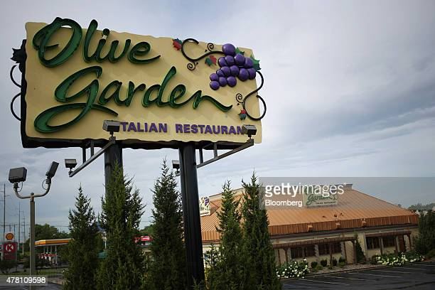Darden Restaurants Inc Olive Garden signage stands outside of a location in Louisville Kentucky US on Monday June 22 2015 Darden Restaurants Inc is...