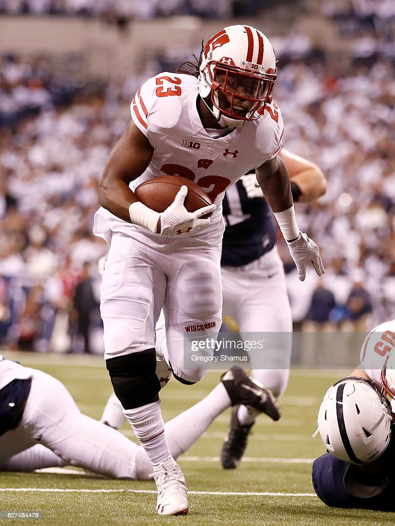Dare Ogunbowale #23 of the Wisconsin Badgers runs for a touchdown during the second quarter of the Big Ten Championship game against the Penn State Nittany Lions at Lucas Oil Stadium on December 3, 2016 in Indianapolis, Indiana.