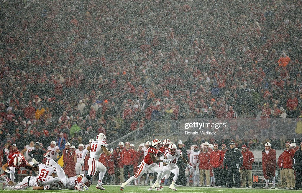 Dare Ogunbowale #23 of the Wisconsin Badgers runs the ball against the Nebraska Cornhuskers at Camp Randall Stadium on November 15, 2014 in Madison, Wisconsin.