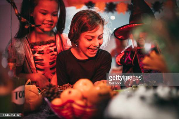 dare you to touch it! - halloween party stock photos and pictures
