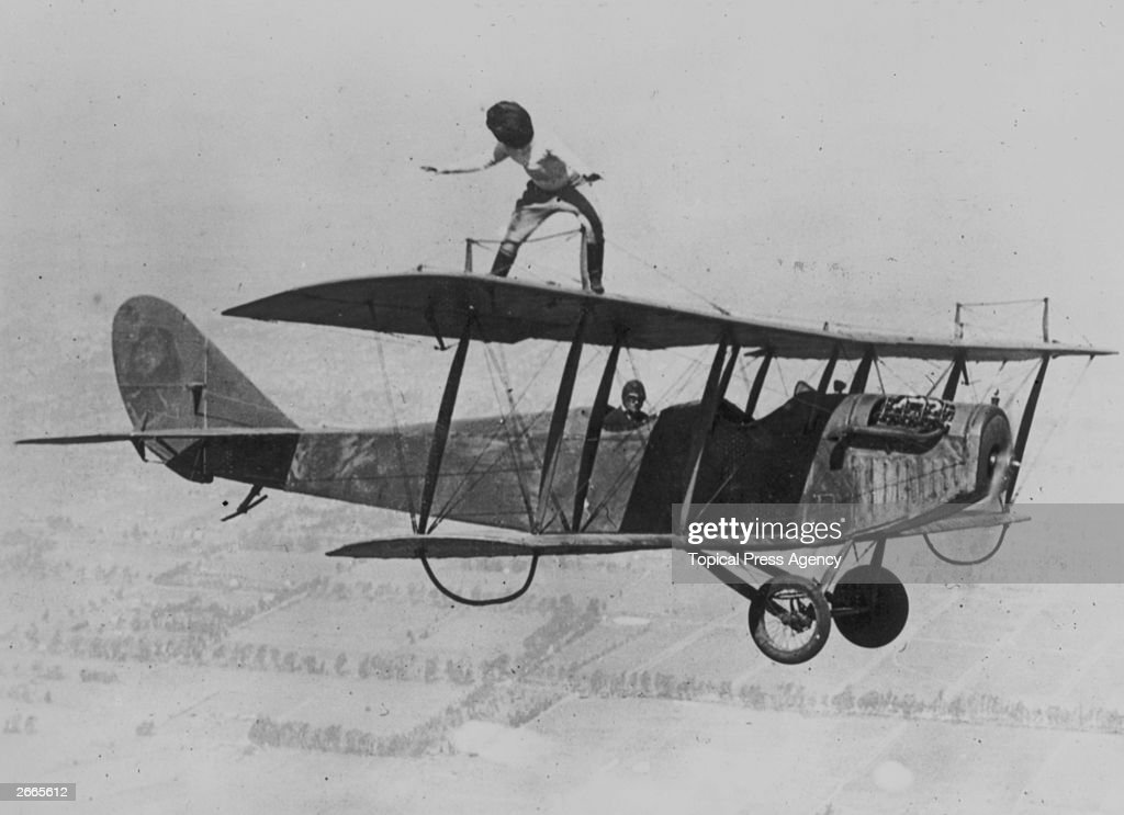 Daredevil Gladys Roy walking the wings of a Curtiss JN-4 'Jenny' biplane over Los Angeles whilst blindfolded, March 29, 1924.