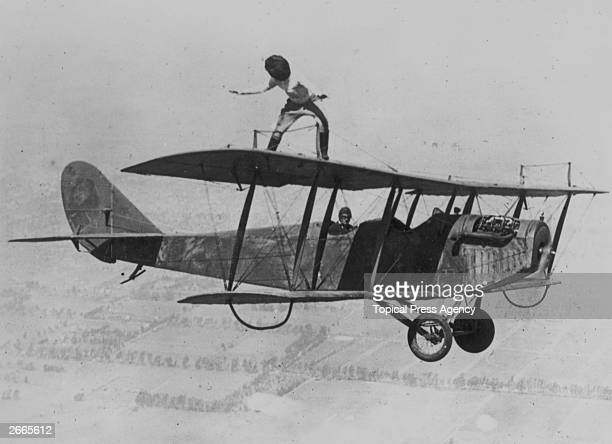 Daredevil Gladys Roy walking the wings of a Curtiss JN4 'Jenny' biplane over Los Angeles whilst blindfolded March 29 1924