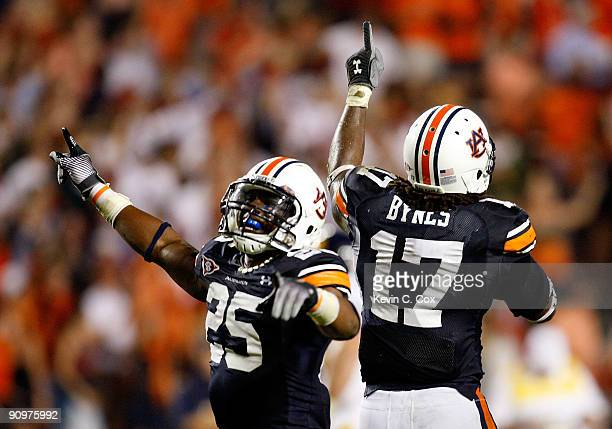 Daren Bates and Josh Bynes of the Auburn Tigers celebrate Bynes interception in the final minutes of their 4130 win over the West Virginia...