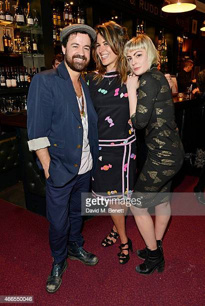 """Daren James, Lliana Bird and Sunta Templeton attend a private view of """"He Wore Dreams Around Unkind Faces"""", an exhibition by Noel Fielding, at the..."""
