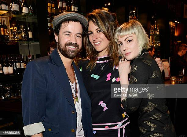 Daren James Lliana Bird and Sunta Templeton attend a private view of He Wore Dreams Around Unkind Faces an exhibition by Noel Fielding at the Royal...