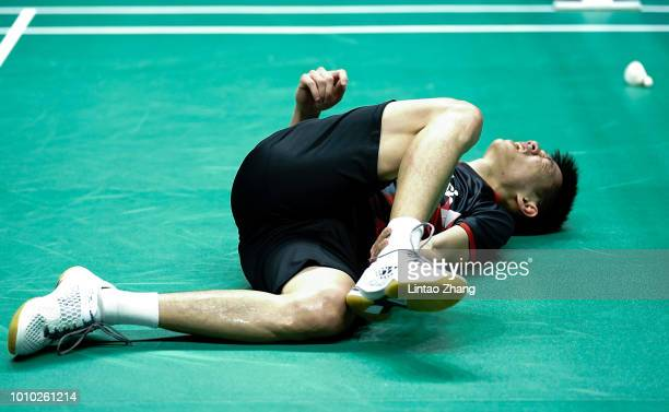 Daren Liew of Malaysia falls to the floor as he competes against Kanta Tsuneyama of Japan during their men's single quarter final match during the...