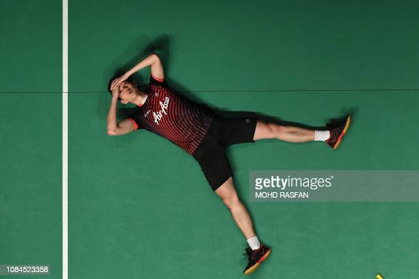 Daren Liew of Malaysia reacts after winning against Shi Yuqi of China during their men's singles match at the Malaysia Masters badminton tournament...