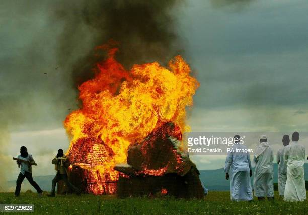 Darfur huts are burnt near Gleneagles by survivors reenacting the burning and distruction of their village by Janjaweed militia ahead of the G8 summit