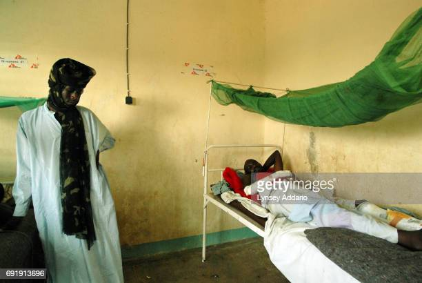 Darfur rebel fans a wounded fellow soldier in a local hospital in Iriba in northeastern Chad October 14 2006 Fierce fighting continues between...