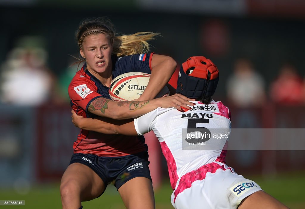 Daria Babkova of Russia is tackled by Mayu Shimizu of Japan during the match between Russia and Japan on Day One of the Emirates Dubai Rugby Sevens - HSBC Sevens World Series at The Sevens Stadium on November 30, 2017 in Dubai, United Arab Emirates.
