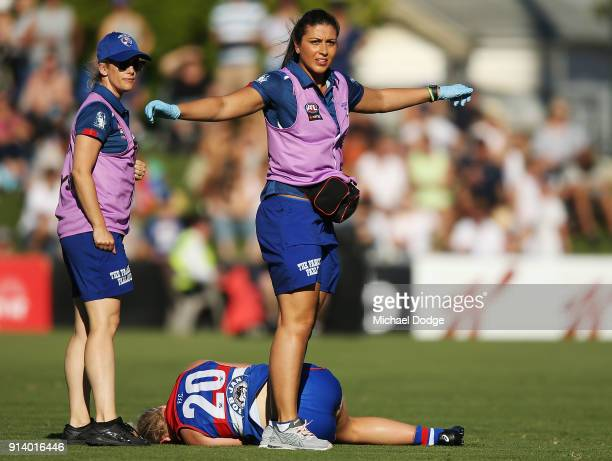 Daria Bannister of the Bulldogs injured her knee after a tackle on Cassie Davidson of the Dockers during the round one AFLW match between the Western...
