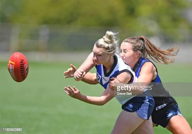 Daria Bannister of the Kangaroos handballs during a North Melbourne Kangaroos AFLW Match Simulation Training Session at North Hobart Oval on December...