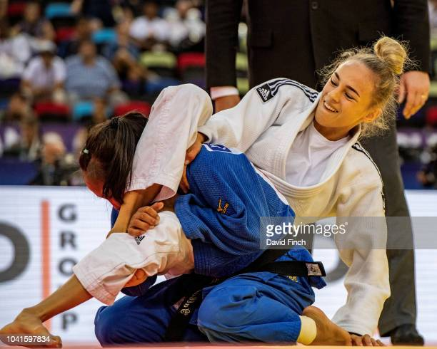 Daria Bilodid of the Ukraine manoeuvres Otgontsetseg Galbadrakh of Kazakhstan into a hold for 20 seconds to win their quarterfinal contest by an...