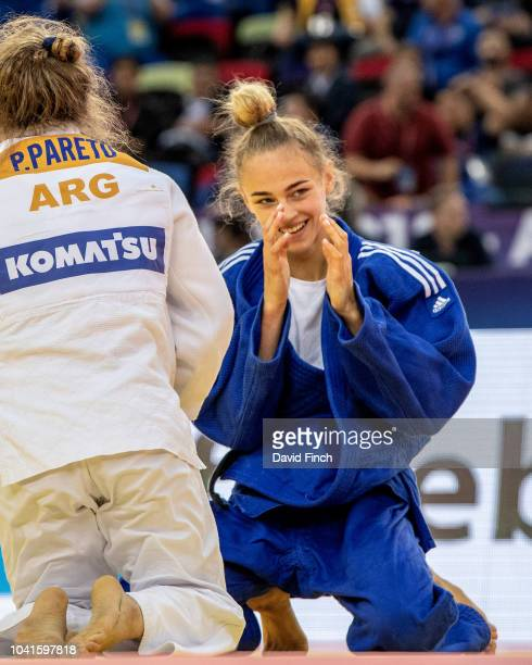 Daria Bilodid of the Ukraine reacts when she realises that she will be fighting for the gold medal after defeating Rio Olympic champion Paula Pareto...