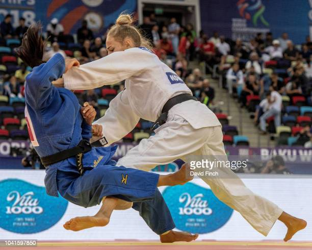 Daria Bilodid of the Ukraine throws Otgontsetseg Galbadrakh of Kazakhstan without a score eventually defeating her with a hold for ippon on her way...