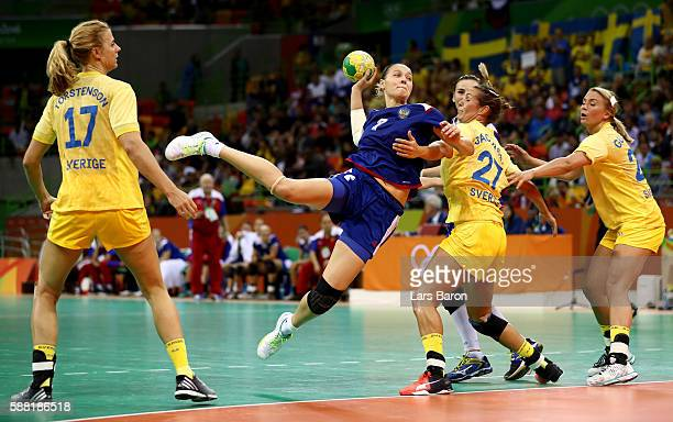 Daria Dmitrieva of Russia is challenged by Sabina Jacobsen of Sweden during the Womens Preliminary Group B match between Russia and Sweden at Future...