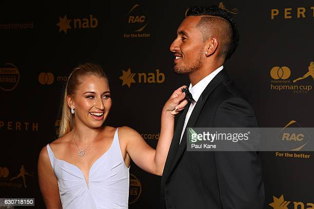 Daria Gavrilova adjusts Nick Kyrgios' tie on the blue carpet during the Hopman Cup New Year's Eve Gala at the Crown Perth on December 31 2016 in...