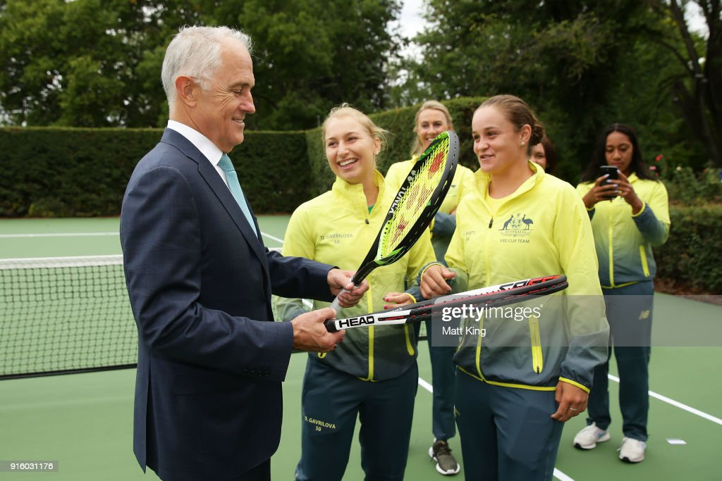 Daria Gavrilova (L) and Ashleigh Barty (R) of Australia present the Prime Minister of Australia Malcolm Turnbull two tennis raquests as a gift during a Prime Minister's reception at The Lodge ahead of the Fed Cup tie between Australia and the Ukraine on February 9, 2018 in Canberra, Australia.