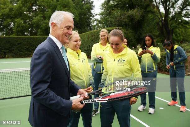 Daria Gavrilova and Ashleigh Barty of Australia present the Prime Minister of Australia Malcolm Turnbull two tennis raquests as a gift during a Prime...