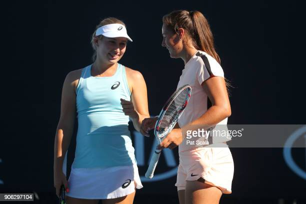 Daria Gavrilova of Australia and Daria Kasatkina of Russia talk tactics in their first round women's doubles match against Vania King of the United...