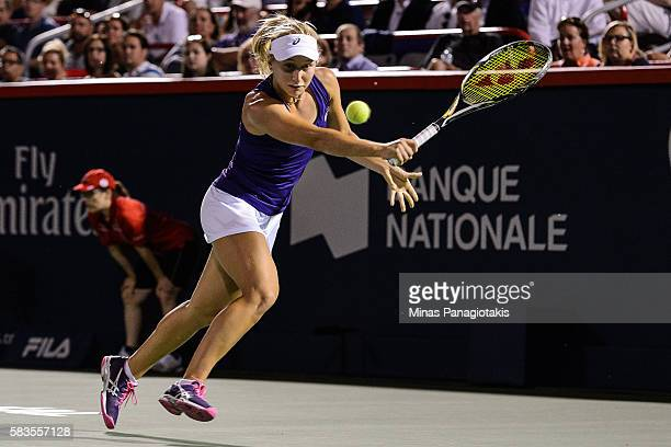 Daria Gavrilova of Australia hits a backhanded return against Simona Halep of Romania during day two of the Rogers Cup at Uniprix Stadium on July 26...