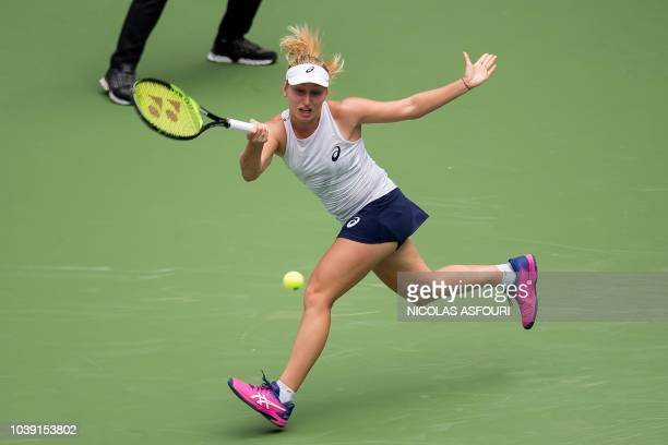 Daria Gavrilova of Australia hits a return against Jelena Ostapenko of Latvia during their women's singles second round match of the WTA Wuhan Open...