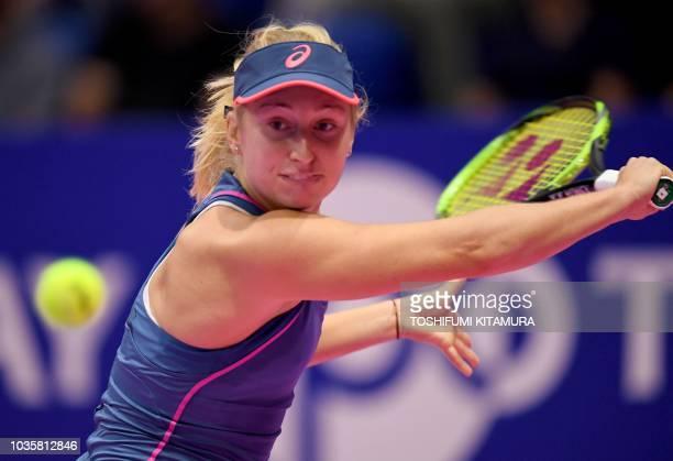Daria Gavrilova of Australia hits a return against Karolina Pliskova of the Czech Republic during their women's singles second round match at the Pan...