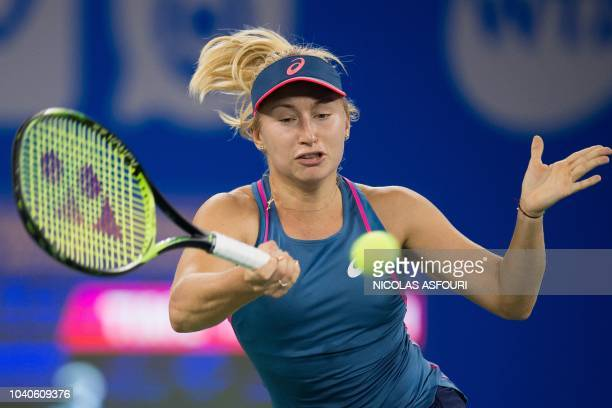 Daria Gavrilova of Australia hits a return against Wang Qiang of China during their women's singles third round match of the WTA Wuhan Open tennis...