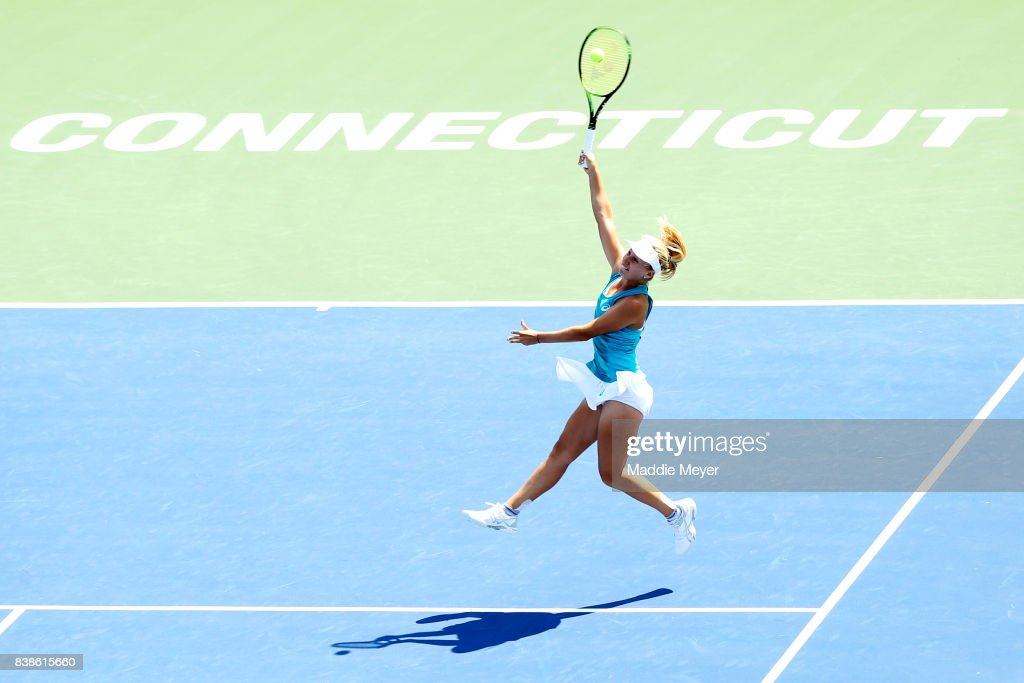 Daria Gavrilova of Australia jumps to returns a shot to Kirsten Flipkens of Belgium during Day 7 of the Connecticut Open at Connecticut Tennis Center at Yale on August 24, 2017 in New Haven, Connecticut.