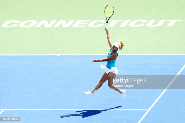 Daria Gavrilova of Australia jumps to returns a shot to Kirsten Flipkens of Belgium during Day 7 of the Connecticut Open at Connecticut Tennis Center...