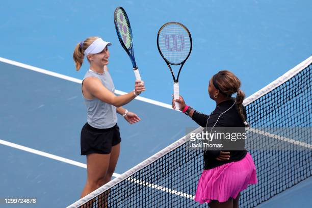 Daria Gavrilova of Australia meets Serena Williams of The United States of America at the net following their Women's Singles Round of 32 match...