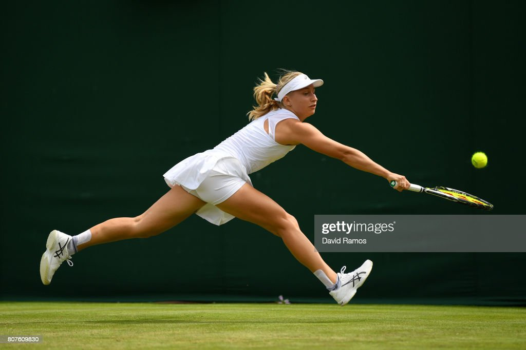 Daria Gavrilova of Australia plays a backhand during the Ladies Singles first round match against Petra Martic of Croatia on day two of the Wimbledon Lawn Tennis Championships at the All England Lawn Tennis and Croquet Club on July 4, 2017 in London, England.