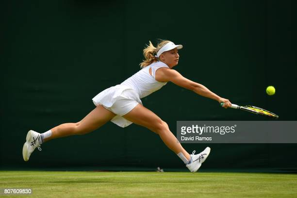 Daria Gavrilova of Australia plays a backhand during the Ladies Singles first round match against Petra Martic of Croatia on day two of the Wimbledon...