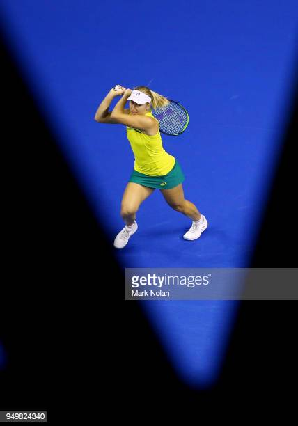 Daria Gavrilova of Australia plays a backhand in her match against Quirine Lemoine of the Netherlands during the World Group PlayOff Fed Cup tie...
