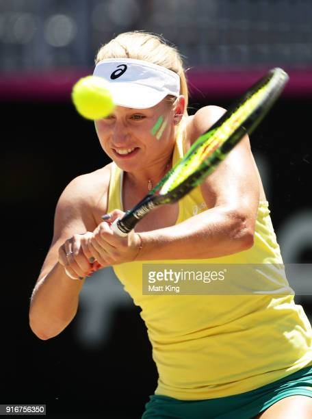 Daria Gavrilova of Australia plays a backhand in her singles match against Nadiia Kichenok of Ukraine during the Fed Cup tie between Australia and...