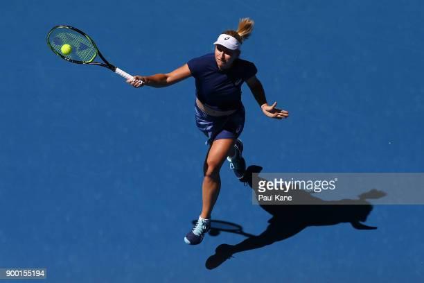 Daria Gavrilova of Australia plays a forehand to Eugenie Bouchard of Canada in her singles match on day 2 of the 2018 Hopman Cup at Perth Arena on...